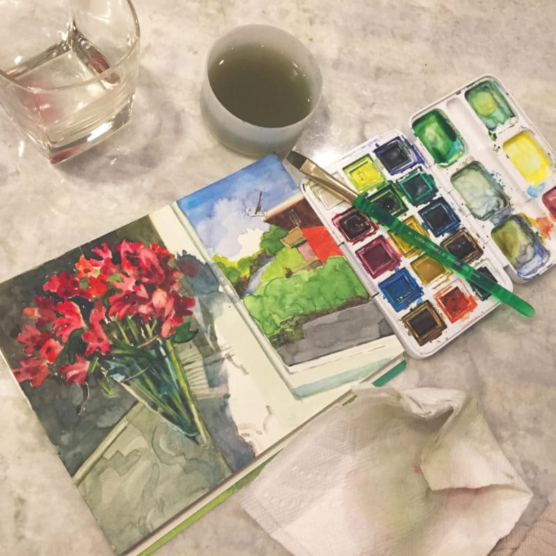 painting a watercolor still life on the kitchen counter