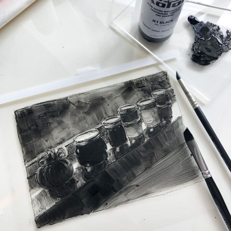 a dark field monotype in process on a sheet of plastic