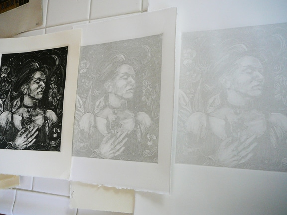 A dark field monotype and two monotype ghost prints, side by side for comparison