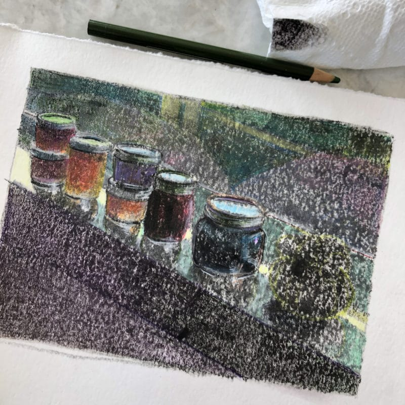 Colored pencil being used on a failed monotype print to define shape and add color and interest