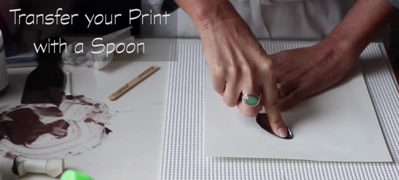 using a spoon to transfer a print to paper