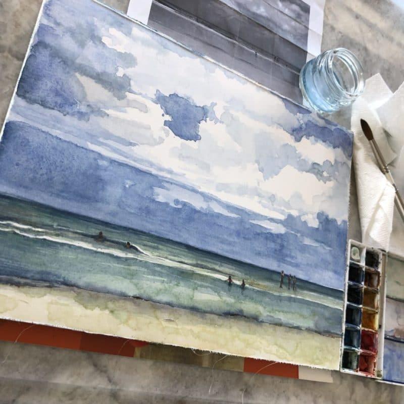a watercolor cloud landscape painting in progress