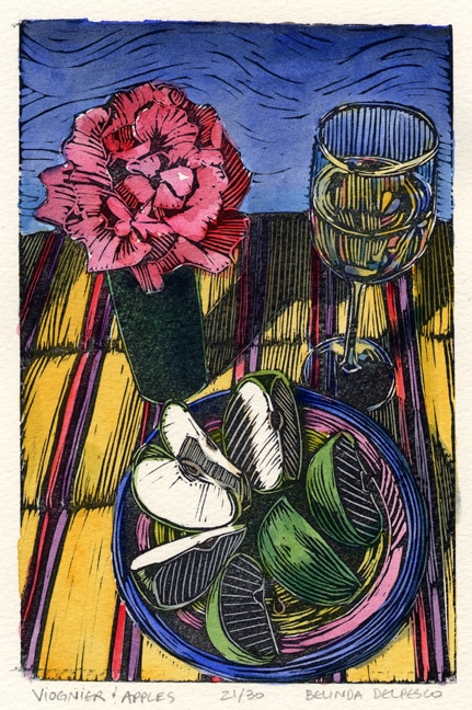 a linocut with watercolor of a rose in a bud vase, a glass of white wine and a plate with green apple slices on a striped cloth