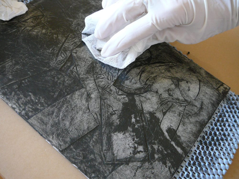 Wiping ink from a figurative collagraph plate